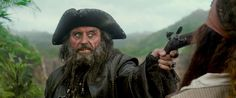 Ian McShane as 'Blackbeard' w' a gun to Johnny Depp 'Captain Jack Sparrow' 'On Stranger Tides' (still from film)