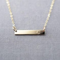 I can engrave anything you like!   Initial Bar Necklace by LilyEmmeJewelry | Hatch.co