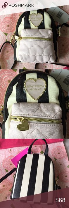 """Betsey Johnson NWT Mini Backpack + 2 ban.do... Brand new adorable Betsey bag is a cross body pretending to be mini backpack. When you buy this I will include TWO Ban.do drink sleeves that belong in this perfect bag ($10 value). Cream and black stripes contrast with pale pink quilted stitched hearts. BJNY heart logo matches in pale pink w tiny pearls and gold balls. Delights with Betsey's whimsical design and playful ideas. Classic rose fabric inside. Measures about 7"""" x 8"""" x 4"""" across. Great…"""