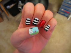 wizard of oz wicked witch of the east nails art design house ruby red slippers red glitter black and white stripes