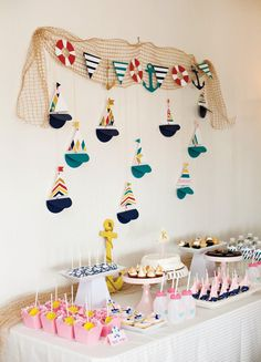 An Adorable Little Sailor Girl Party {Nautical First Birthday} with anchor bunting, lifesaver bags, sail bot decorating, pretty cake pops and more!