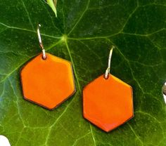 Enameled orange hexagon earrings by kristybrabydesign on Etsy