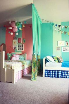I like this idea of hanging curtians to divide the room. The girls would love this.