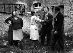 In the Normandy village of Liesville, angry French patriots take hold of Juliette Audieve, thought to have been a collaborator with the Germans. It appears the two ladies standing casually by are also partisans.