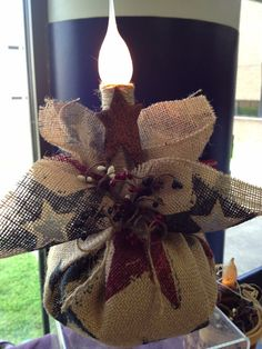 Americana burlap candle. I LOVE this! Perfect for outdoor decorating.
