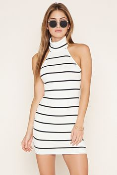 A ribbed knit bodycon dress with a turtleneck, stripes, and a sleeveless cut.