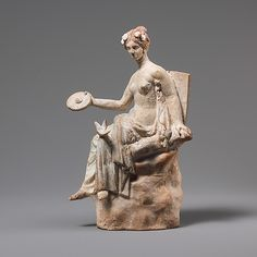 Terracotta statuette of Aphrodite seated on a rock,Hellenistic period,3rd century BC  Greek South Italian