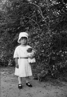 Little Girl with Curly Headed Doll by ChrisWarren1956, via Flickr