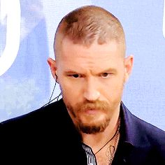 Tom Hardy looking unimpressed at that sexist question about Mad Max Fury Road - Cannes , May 2015