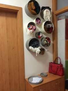 Ikea hack - round baskets on the wall. Maybe good for yarn storage.