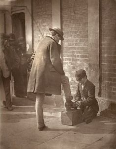 Shoe Shining. (Photo by John Thomson/LSE Digital Library)