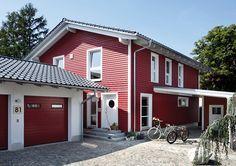 Dieses Fertighaus im schwedischen Landhausstil mit der passenden klassischen Farbe der Fassade verströmt eine menge Ferienhaus-Appeal.