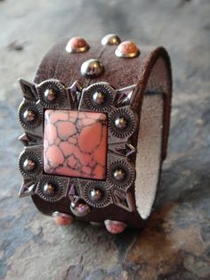 Coral cuff, love this one! http://www.horsesandheels.com/2012/02/cowgirls-giveaway/