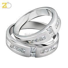 Cincin Kawin Cicabako, dengan desain yang cantik, cincin berhiaskan taburan batu cubic zirconia sehingga nampak begitu mewah dan elegan. Finishing akhir kombinasi doff dan gilap dilapis dengan emas putih (rhodium). Cocok untuk Cincin Kawin, cincin nikah, cincin tunangan model elegan maupun hadiah/kado cincin.