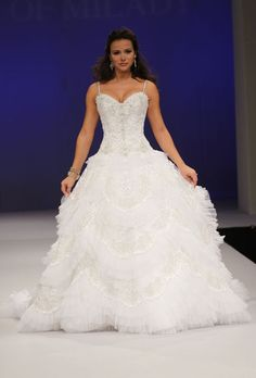 Brides.com: . Sleeveless beaded organza ball gown wedding dress with a v-neckline and spaghetti straps, Eve of Milady