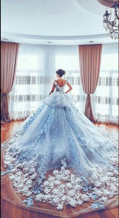What a spectaular train on this wedding gown! The surf of white blossoms against the sea of the dress trailing behind the bride is simply breathtaking. See more wedding gowns on Wedding Vows. Quince Dresses, Prom Dresses, Evening Dresses, Light Blue Quinceanera Dresses, Ball Gown Dresses, Dress Prom, Robes Disney, Bridal Gowns, Wedding Gowns