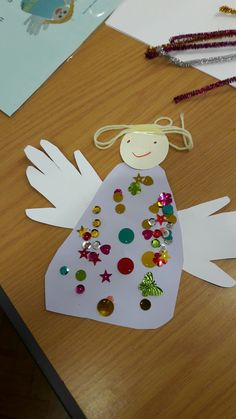Easy angel craft using hand and foot prints. Messy Church Christmas.