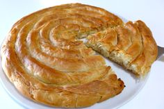 Spiral-shaped Greek Cheese pie recipe (Kichi Kozanis) - My Greek Dish Greek Cheese Pie, Cheese Pies, Greek Recipes, Pie Recipes, Gourmet Recipes, Greek Meals, Pastry Recipes, Recipies, Burek Recipe