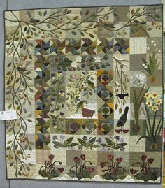 Orchid quilt. I adore the APPLIQUE - especially the vine and leaves, I love the pieced blocks also.
