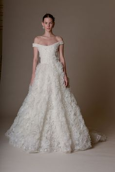 Off the shoulder wedding dress with a floral tulle texture | www.onefabday.com
