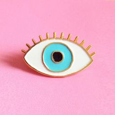 He encontrado este interesante anuncio de Etsy en https://www.etsy.com/es/listing/247790029/perno-de-ojo-azul