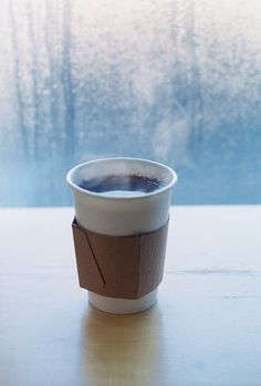 A hot cup of coffee on a rainy day. Pure comfort