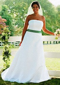 Strapless satin A-line gown with cuff neckline and pleated sash.   Sweep train. White andIvory available online. Shown with satin sash S400.Pleae note: Color sashes & ribbons sold separately.