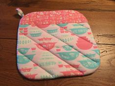NEW Handmade Potholder Vintage Print - Matches the Pink and or Turquoise Gooseberry Print and more Specifics - When creating potholders, I use quality quilt fabric, layered with cotton batting and Insul Brite. I machine quilt and include a two inch hanger. Size is Approx 7 1/2 x 7 1/2