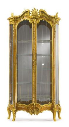 JOSEPH-ÉMMANUEL ZWIENER FL. CIRCA 1875-1900 A LARGE AND VERY FINE PAIR OF GILT-BRONZE MOUNTED KINGWOOD DOUBLE-DOOR VITRINES PARIS, LATE 19TH CENTURY bombé to the front and convex to the sides, each vitrine fitted with double doors opening to a mirrored interior and fitted with five glass shelves, the bronze mounts marked ZN and with their respective serial numbers from the workshop master patterns height 7 ft. 2 1/2 in.; width 43 1/2 in.; depth 15 3/4 in. / sothebys.com