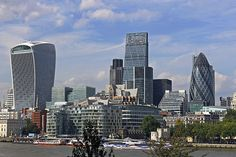 Modern office buildings towering over the historical Tower of London. From left to right the main ones are 20 Fenchurch Street, AKA the Walkie Talkie, 122 Leadenhall Street, AKA The Cheese Grater and 30, St Mary