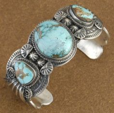 Handcrafted sterling silver and Royston turquoise cuff bracelet by Navajo artisan Leo Dawes. Leo is a multi-talented silversmith who specializes in creating exquisite old style Navajo jewelry.
