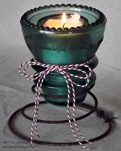 Quick and Easy Upcycle - Bed Spring and Insulator Votive - I used rusty bed springs from a friend's back yard and an aqua glass insulator from my garage to crea… Rusty Bed Springs, Box Springs, Bed Spring Crafts, Diy Bett, Old Beds, Glass Insulators, Insulator Lights, Electric Insulators, Glass Bottles