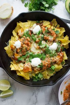 This healthy butternut squash chilli makes the perfect topping for these vegetarian nachos. Add your favourite toppings for a delicious twist on a classic!