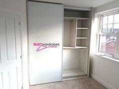 Two sliding door built in #wardrobe from the floor to the ceiling. Opened door view