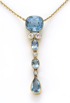 An aquamarine and diamond pendant necklace  mounted in fourteen karat gold; length: 16 1/4in.