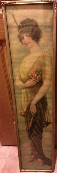 "Here is a hard to find 1915 Calendar from Pabst Extract (yes the beer maker). It features Alfred Everitt Orr's Panama Girl on the front, and has the calendar and various text on the back. It measures approx. 37"" long and 7 1/4"" wide. It is framed with glass on the front, displaying the girl. A piece of cardboard covers the back of the print. This print is signed ""Alfred Everitt Orr 1914."" The back features an advertisement for Pabst Extract, ""The Best Tonic,"" as well as a 1915 calendar."