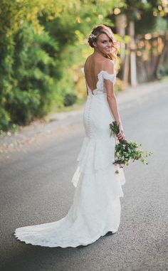 I love this off-the-shoulder wedding dress. The #lowback adds a sexy feel to this stunning #lace dress. | The Hottest Wedding Dress Trends of 2015