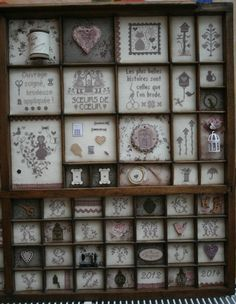 Cross stitch in portions of what looks like a printers drawer. Cross Stitch Love, Cross Stitch Patterns, Chic Shadow, Letterpress Drawer, Mixed Media Boxes, Shadow Box Memory, Printers Drawer, Button Decorations, Chart Design