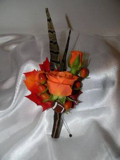 Customized for the groom.  Football and hunting are his favorite!  Floral Designs by Jodi