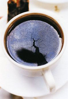 wolfgang tillmans, I like this because there is an image in the cup of coffee, this looks like a crack in the ground, and when its in the coffee it gives that effect of there being a crack in the coffee