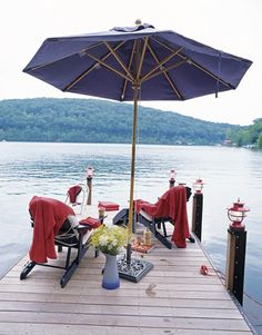 A private dock is the ultimate lake cottage accessory, a place for dozing, diving, daydreaming: choose your pastime. Throughout the summer the owner of the rehabilitated 1939 cottage in Connecticut entertains guests by running them across the lake for picnics in a classic 1960s Chris-Craft motorboat. Lanterns and towels from L.L. Bean.