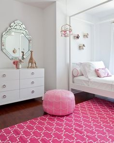 pink and white nursery with rug