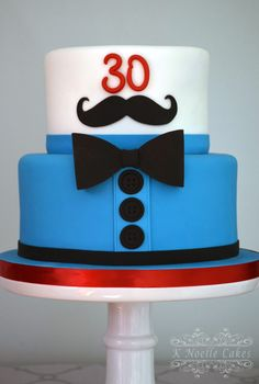 Mustache and bow tie cake by K Noelle Cakes