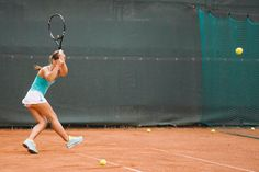 Tennis player in motion hits the ball by T-REX & Flower for Stocksy United New York City Location, Cardiovascular Training, Serena Williams, Tennis Players, T Rex, Tennis Racket, Summertime, Basketball Court, The Unit