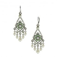 "These earrings are set in silver tones, adorned with pearls and peridot stones. Approximately 2"" long."