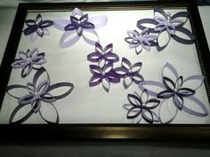 My step daughters gift made of toliet paper rolls & cheap frame from dollar store.