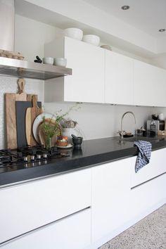 white, black, white textured splash, terrazzo-esque floors decor8blue12