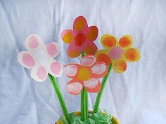 Spring Fingerprint Flowers Craft  This is an easy flowers craft you can make with construction paper and pipe cleaners with fingerprint accents.    Materials:        * construction paper      * scissors      * green pipe cleaners      * tape      * paints