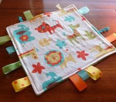 Tag blanket #blanket #baby #sewing Even though chase is three, he still loves to hold the tag in his hand.  I might make this for him.