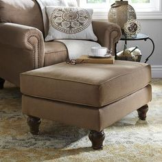 Genius is in the details, and our Alton collection has a special genius for relaxation. A large, blocky body with padded corners and an extra-thick cushion give the Alton Ottoman an indulgent feel. Underneath, a hardwood frame provides durability and integrity. As for the turned legs? Well, sometimes even geniuses have to show off.